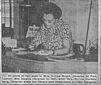 1947 newspaper photo librarian helping patron